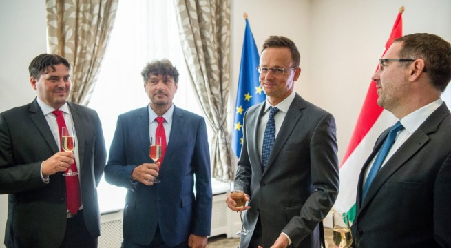 Boros László, Tarány Gábor,, Szijjártó Péter és Csizi Péter. Fotó: Balogh Zoltán, MTI